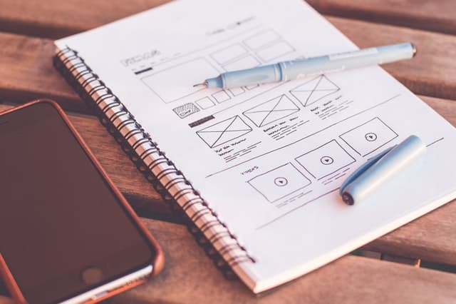 Web_Design_Sketching_Wireframe_Notebook_Pen_Phone